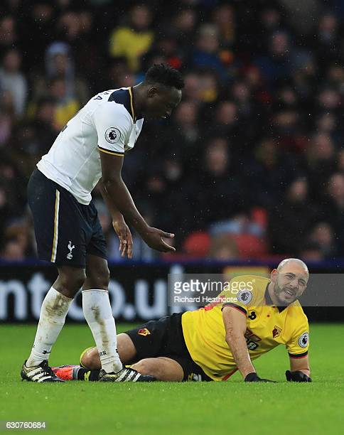 Nordin Amrabat of Watford reacts as he is injured alongside Victor Wanyama of Tottenham Hotspur during the Premier League match between Watford and...