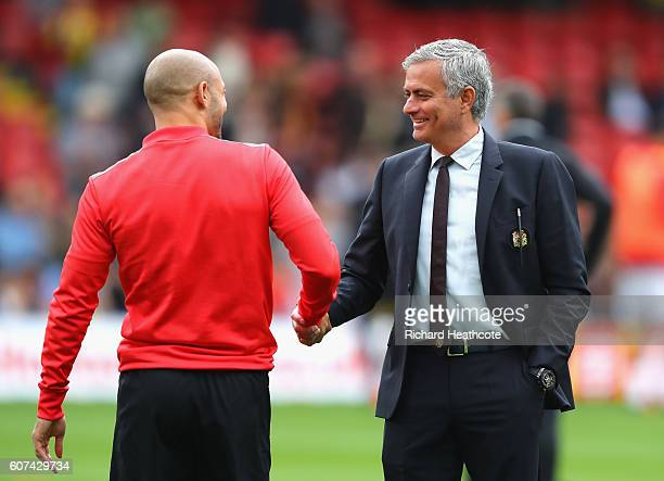 Nordin Amrabat of Watford speaks to Jose Mourinho Manager of Manchester United before kick off during the Premier League match between Watford and...