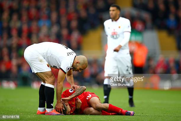 Nordin Amrabat of Watford speaks to Philippe Coutinho of Liverpool during the Premier League match between Liverpool and Watford at Anfield on...