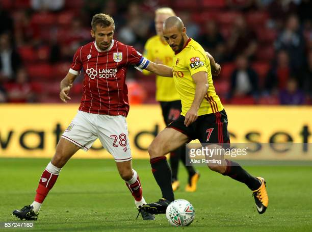 Nordin Amrabat of Watford takes on Gary O'Neil of Bristol City during the Carabao Cup Second Round match between Watford and Bristol City at Vicarage...