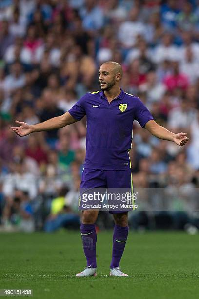 Nordine Amrabat of Malaga CF protests to the referee after being red carded during the La Liga match between Real Madrid CF and Malaga CF at Estadio...