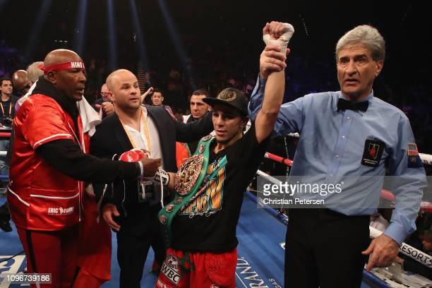 Nordine Oubaali celebrates after winning by unanimous decision over Rau'shee Warren with referee Vik Drakulich during the WBC bantamweight...