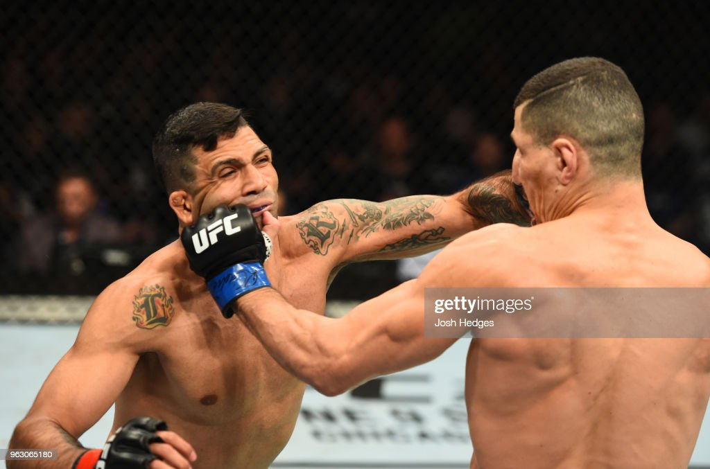 Nordine Taleb of France punches Claudio Silva of Brazil in their welterweight bout during the UFC Fight Night event at ECHO Arena on May 27, 2018 in Liverpool, England.