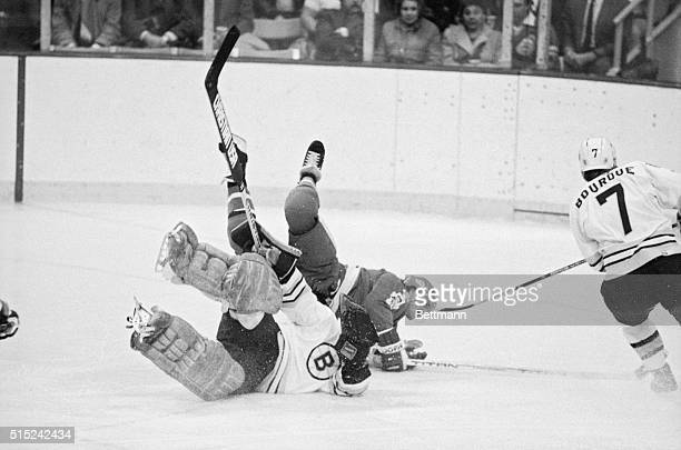 Nordique Michel Goulet and Bruin goalie Doug Keans fall after colliding during 2nd period at the Boston Garden