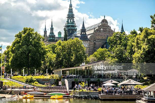 nordiska museum and people enjoying summer, stockholm, sweden - djurgarden stock pictures, royalty-free photos & images