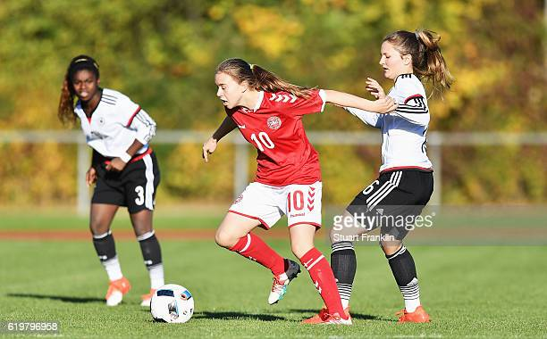 Noreen Guenneweg of Germany is challenged by Emma Snerle of Denmark during the International Friendly match between U16 Girl's Germany and U16 Girl's...