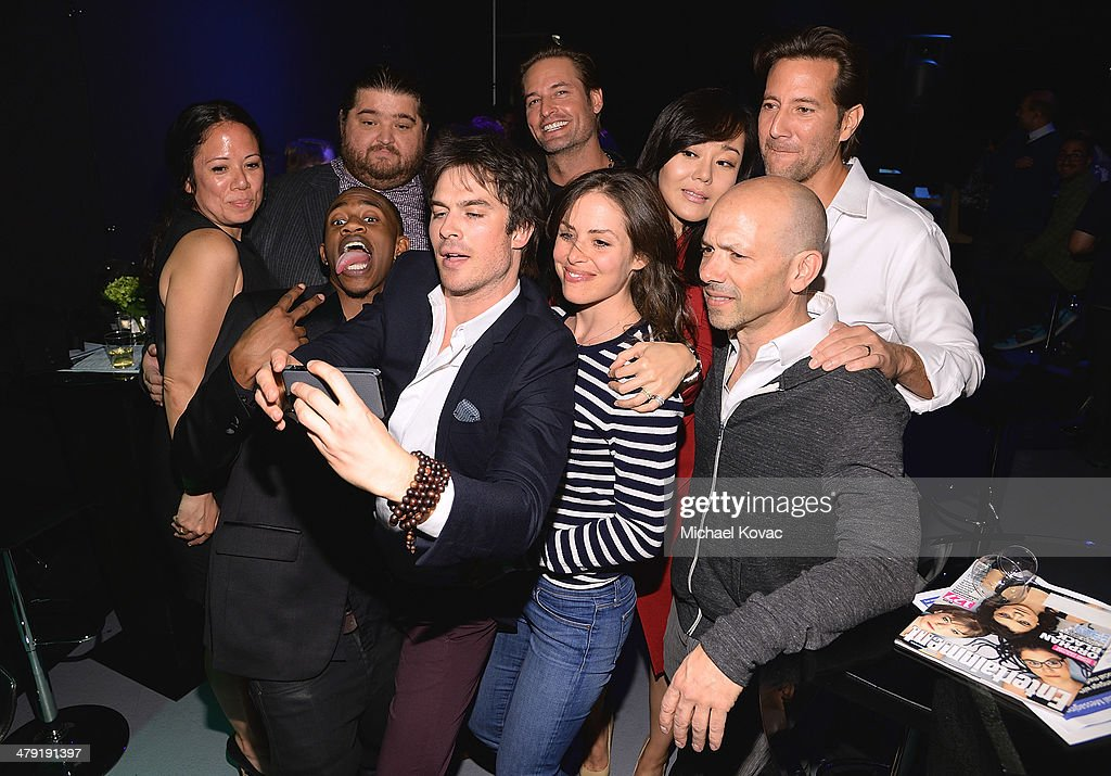 Noreen O'Toole, Malcolm David Kelley, Jorge Garcia, Ian Somerhalder, Josh Holloway, Samantha Thomas, Yunjin Kim, John Bernstein, and Henry Ian Cusick pose for a selfie backstage at The Paley Center For Media's PaleyFest 2014 Honoring 'Lost: 10th Anniversary Reunion' at Dolby Theatre on March 16, 2014 in Hollywood, California.
