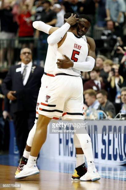 Norense Odiase and Justin Gray of the Texas Tech Red Raiders celebrate after beating the Florida Gators 6966 in the second round of the 2018 NCAA...