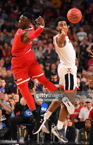 Norense Odiase of the Texas Tech Red Raiders and Braxton Key of the Virginia Cavaliers compete for a loose ball during overtime of the 2019 NCAA...