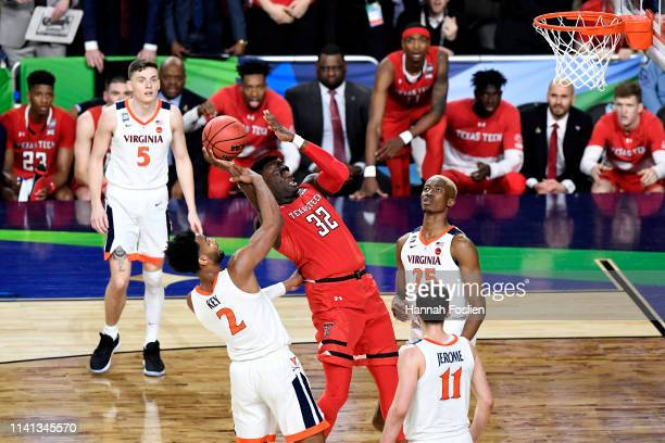 Norense Odiase of the Texas Tech Red Raiders attempts a shot against the Virginia Cavaliers in the second half during the 2019 NCAA men's Final Four...