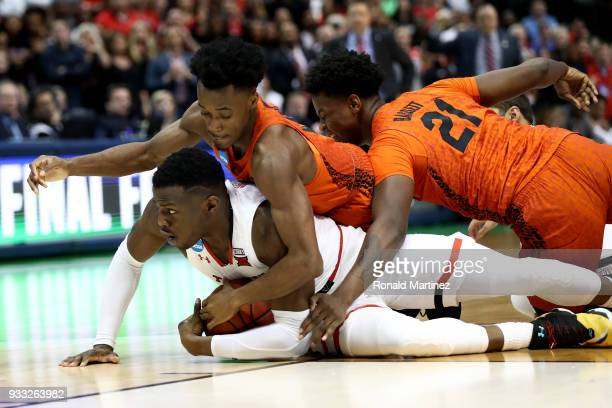 Norense Odiase of the Texas Tech Red Raiders battles for a loose ball against Mike Okauru and Dontay Bassett of the Florida Gators in the second half...