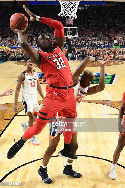 Norense Odiase of the Texas Tech Red Raiders drives to the basket during the second half of the game against the Virginia Cavaliers in the 2019 NCAA...