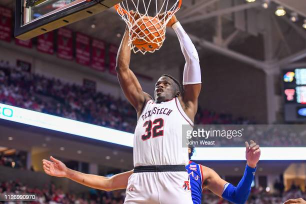 Norense Odiase of the Texas Tech Red Raiders dunks the basketball during the second half of the game against the Kansas Jayhawks on February 23, 2019...