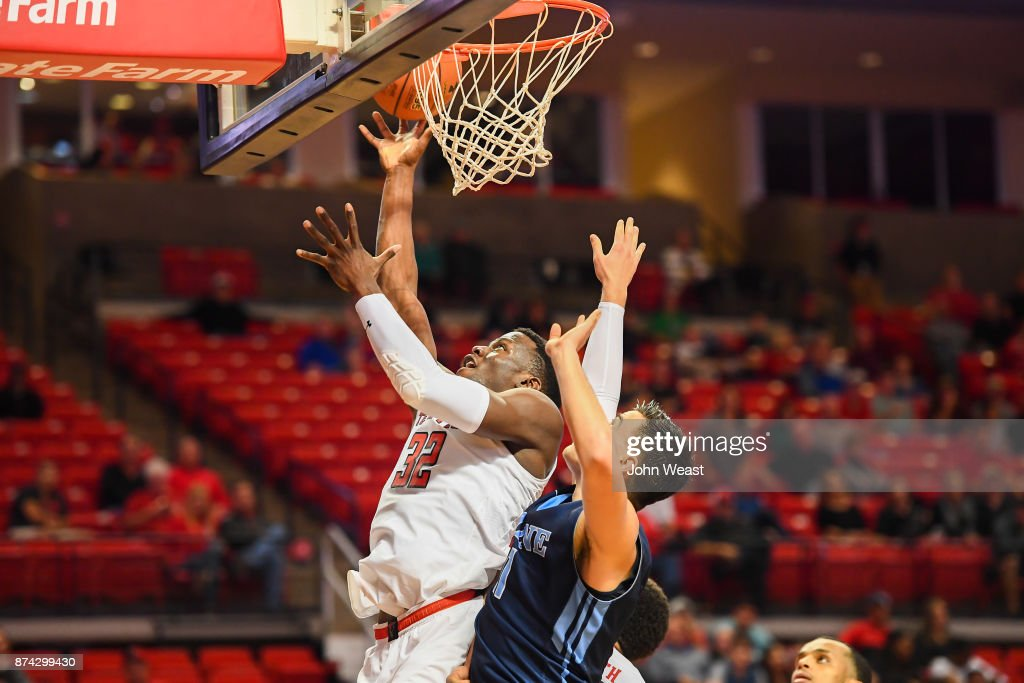 Norense Odiase #32 of the Texas Tech Red Raiders gets a layup against Ilija Stojiljkovic #11 of the Maine Black Bears during the game on November 14, 2017 at United Supermarkets Arena in Lubbock, Texas. Texas Tech defeated Maine 83-44.