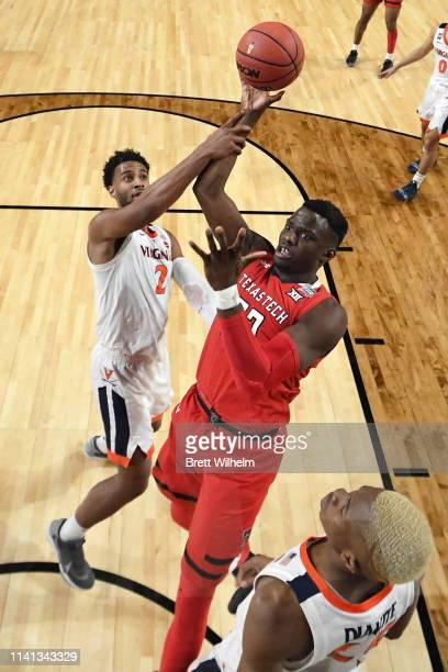 Norense Odiase of the Texas Tech Red Raiders is defended by Braxton Key of the Virginia Cavaliers during the second half of the 2019 NCAA men's Final...