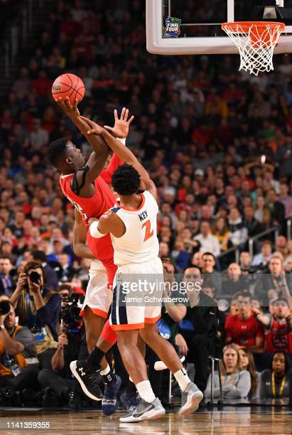 Norense Odiase of the Texas Tech Red Raiders shoots against Braxton Key of the Virginia Cavaliers during the second half in the 2019 NCAA men's Final...
