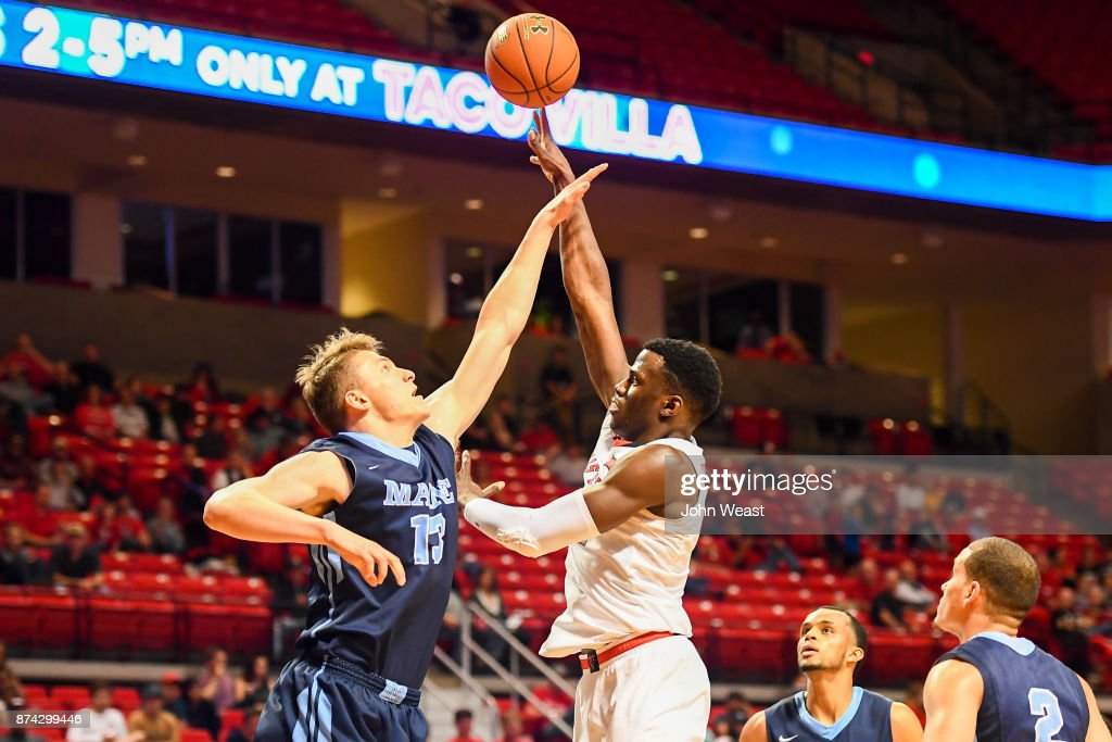 Norense Odiase #32 of the Texas Tech Red Raiders shoots the ball over Miks Antoms #13 of the Maine Black Bears during the game on November 14, 2017 at United Supermarkets Arena in Lubbock, Texas. Texas Tech defeated Maine 83-44.