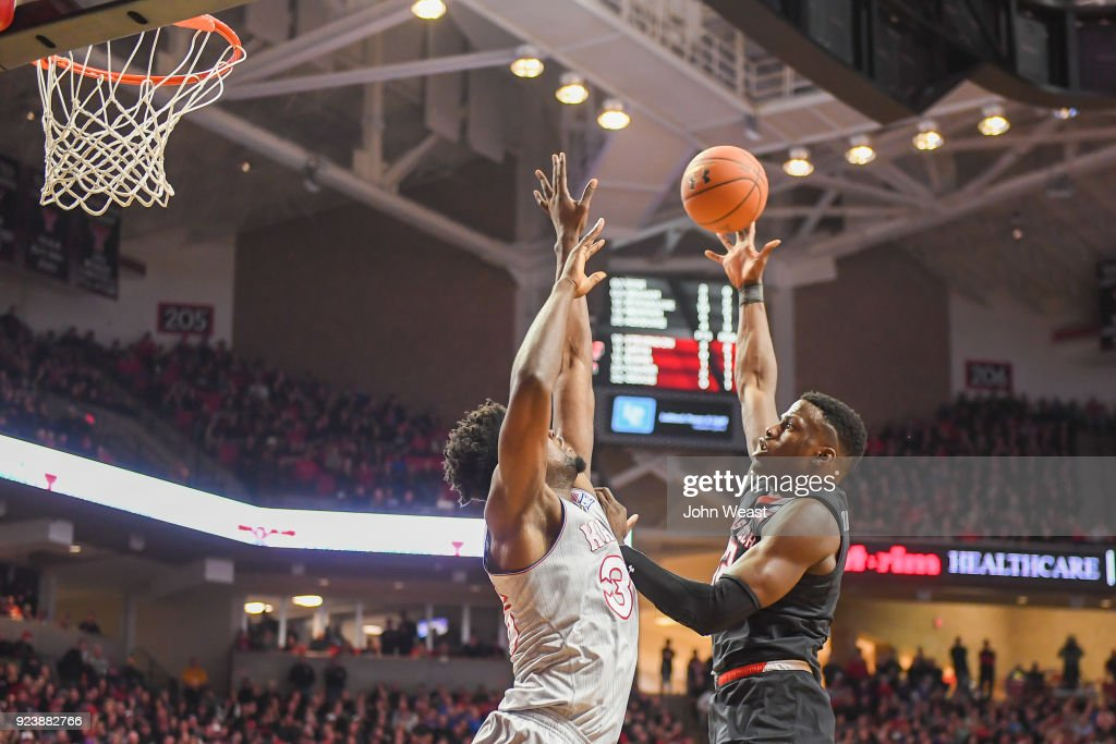 Norense Odiase #32 of the Texas Tech Red Raiders shoots the ball over Udoka Azubuike #35 of the Kansas Jayhawks during the first half of the game on February 24, 2018 at United Supermarket Arena in Lubbock, Texas.