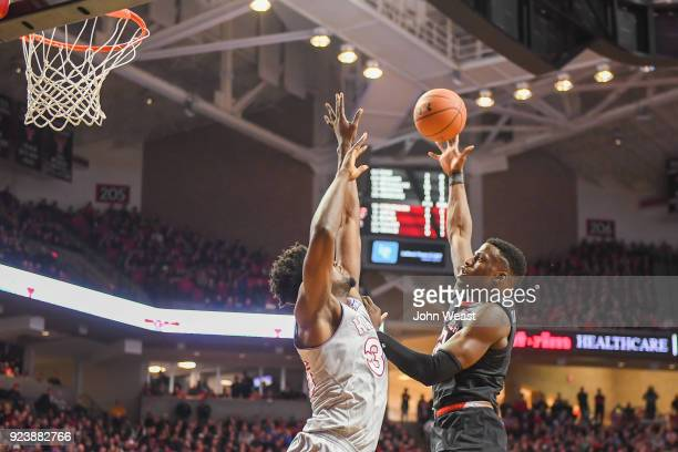 Norense Odiase of the Texas Tech Red Raiders shoots the ball over Udoka Azubuike of the Kansas Jayhawks during the first half of the game on February...
