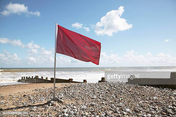 uk, norfolk, red flag at cromer beach - richard drury stock pictures, royalty-free photos & images