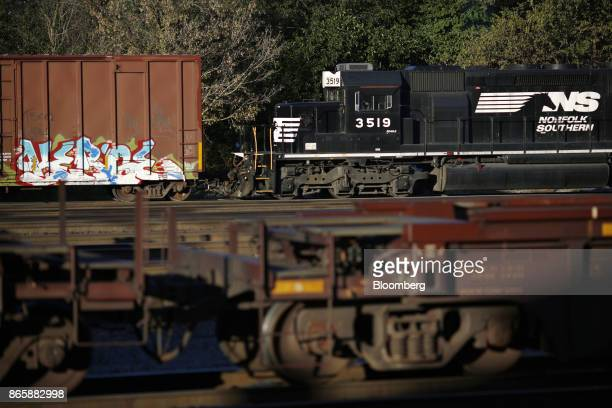 A Norfolk Southern Corp EMD SD402 railroad locomotive hooks up to a freight train in Danville Kentucky US on Tuesday Oct 17 2017 Norfolk Southern...