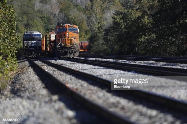 Norfolk Southern Corp left and Burlington Northern Santa Fe LLC locomotives sit parked in Burnside Kentucky US on Tuesday Oct 17 2017 Norfolk...