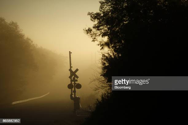 A Norfolk Southern Corp railroad crossing gate stands in Danville Kentucky US on Tuesday Oct 17 2017 Norfolk Southern Corp is scheduled to release...
