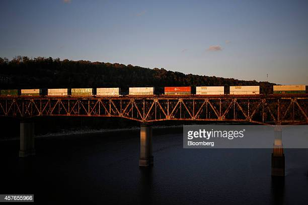 A Norfolk Southern intermodal freight train crosses the Cumberland River in Burnside Kentucky US on Friday Oct 17 2014 Norfolk Southern Corp reported...