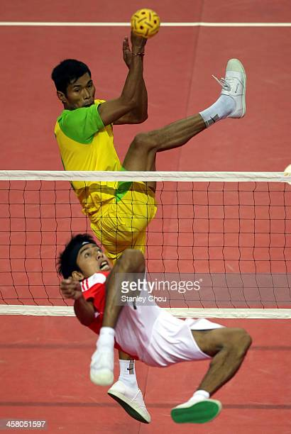 Norfrisal of Indonesia competes with Alung Pyah Tun of Burma during the Men's Team Double Final of the Sepak Takraw Competition between Indonesia and...