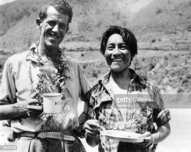 Norgay Tenzing known as Sherpa Tensing Nepalese mountaineer with Edmund Hillary enjoying a snack on their return from the summit Original Publication...