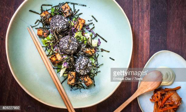 nori and sushi rice ball salad with kimchi - nori stock photos and pictures