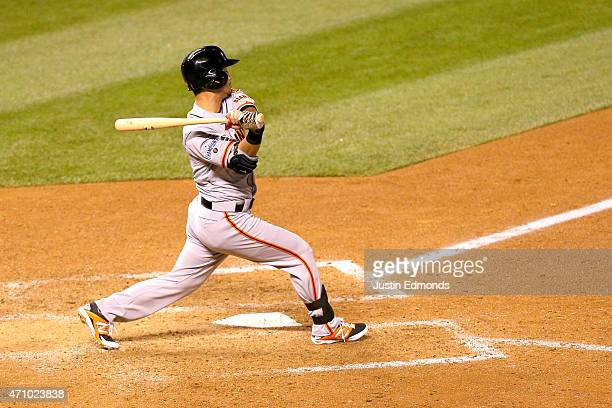 Nori Aoki of the San Francisco Giants bats against the Colorado Rockies at Coors Field on April 24 2015 in Denver Colorado The Rockies defeated the...