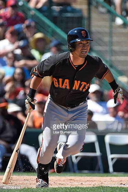 Nori Aoki of the San Francisco Giants bats in the third inning against the Los Angeles Angels of Anaheim during a spring training game at Tempe...
