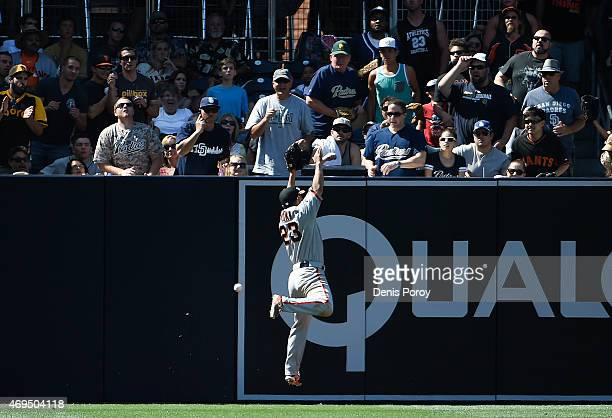 Nori Aoki of the San Francisco Giants can't make the catch on a double hit by Justin Upton of the San Diego Padres during the sixth inning of a...