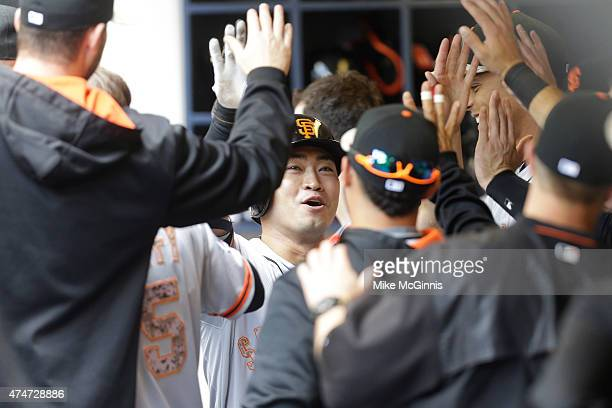 Nori Aoki of the San Francisco Giants celebrates in the dugout after hitting a solo home run in the third inning against the Milwaukee Brewers at...
