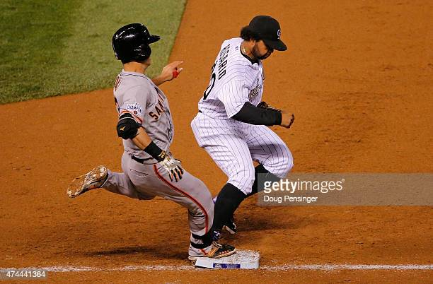 Nori Aoki of the San Francisco Giants grounds out as first baseman Wilin Rosario of the Colorado Rockies records an unassisted put out on the play in...
