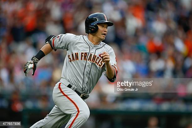 Nori Aoki of the San Francisco Giants heads to first on an RBI single in the second inning against the Seattle Mariners at Safeco Field on June 18...