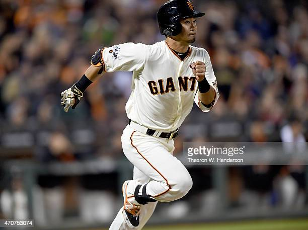 Nori Aoki of the San Francisco Giants hits a ground ball to short stop and races towards first base against the Los Angeles Dodgers in the bottom of...