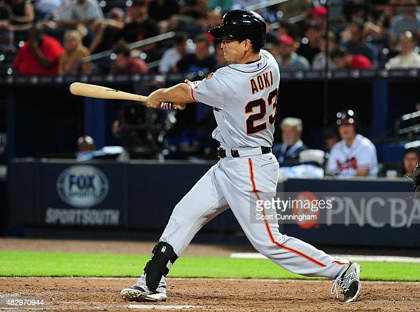 Nori Aoki of the San Francisco Giants hits a ninth inning solo home run against the Atlanta Braves at Turner Field on August 4, 2015 in Atlanta,...