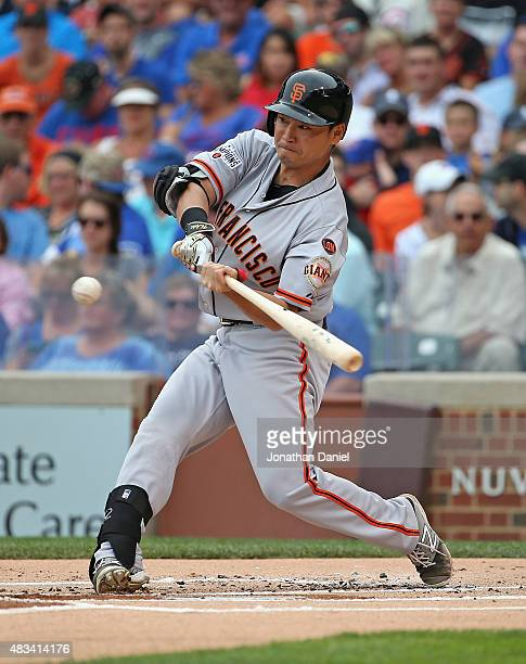 Nori Aoki of the San Francisco Giants hits a pop-up but reaches first base on an error in the 1st inning against the Chicago Cubs at Wrigley Field on...