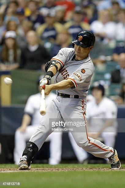 Nori Aoki of the San Francisco Giants hits a single in the fourth inning against the Milwaukee Brewers at Miller Park on May 26, 2015 in Milwaukee,...