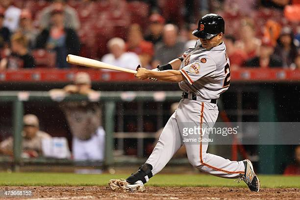 Nori Aoki of the San Francisco Giants hits a triple in the eighth inning against the Cincinnati Reds at Great American Ball Park on May 16, 2015 in...