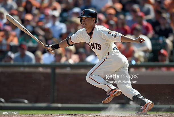 Nori Aoki of the San Francisco Giants hits an infield single against the St Louis Cardinals in the bottom of the seventh inning at ATT Park on August...