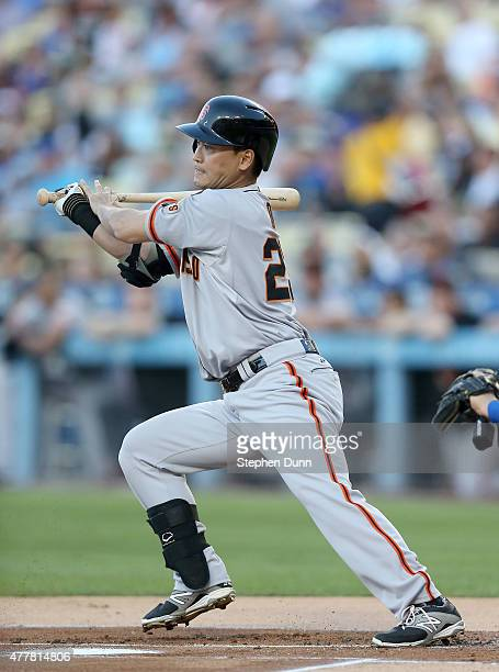 Nori Aoki of the San Francisco Giants hits an infield single in the first inning against the Los Angeles Dodgers at Dodger Stadium on June 19 2015 in...