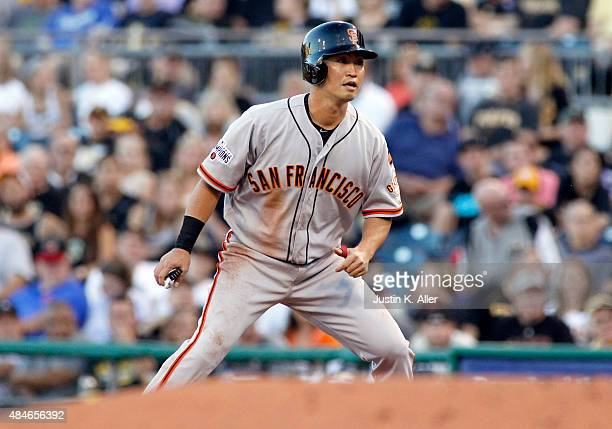 Nori Aoki of the San Francisco Giants on base in the third inning during the game against the Pittsburgh Pirates at PNC Park on August 20 2015 in...