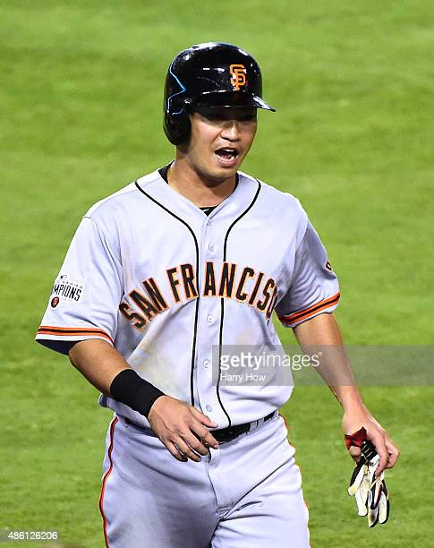 Nori Aoki of the San Francisco Giants reacts to his run to take a 21 lead over the Los Angeles Dodgers during the third inning at Dodger Stadium on...