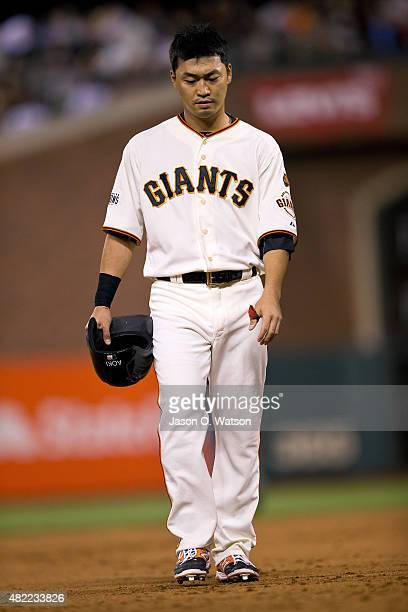 Nori Aoki of the San Francisco Giants returns to the dugout after getting forced out a second base on a double play during the sixth inning against...