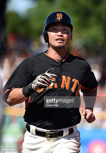 Nori Aoki of the San Francisco Giants runs back to first base during the third inning against the Arizona Diamondbacks at Scottsdale Stadium on March...