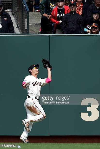 Nori Aoki of the San Francisco Giants runs down a fly ball off the bat of Martin Prado of the Miami Marlins in the top of the six inning at AT&T Park...