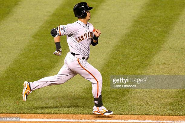 Nori Aoki of the San Francisco Giants runs down the first baseline on a foul ball against the Colorado Rockies at Coors Field on April 24 2015 in...